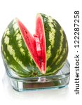 Sliced �¢??�¢??ripe watermelon in a glass bowl isolated on white background - stock photo