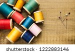 old wooden coils of thread on a ... | Shutterstock . vector #1222883146
