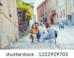 father and mother traveling... | Shutterstock . vector #1222929703