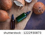 coconut oil with coconuts  ...   Shutterstock . vector #1222930873