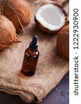 coconut oil with coconuts  ...   Shutterstock . vector #1222930900