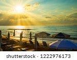 sunbeds and straw umbrellas on...   Shutterstock . vector #1222976173
