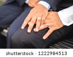 a hand with ring of gay couple... | Shutterstock . vector #1222984513