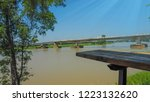 View of beautiful lake, bridge and landscape under the blue sky and sunlight in thailand, It is ideal for holiday and camping trips.