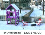 a snow covered backyard with a...