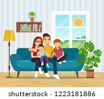 smiling family  on sofa in the... | Shutterstock .eps vector #1223181886