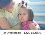 mother holding  crying little...   Shutterstock . vector #1223182009