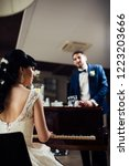 bride plays piano | Shutterstock . vector #1223203666