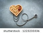 healthy foods. mixed nuts in... | Shutterstock . vector #1223233336