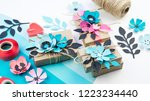 gift wrapping in a box of craft ...   Shutterstock . vector #1223234440