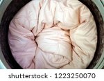 roll up the pink duvet put in a ... | Shutterstock . vector #1223250070