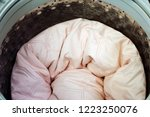 roll up the pink duvet put in a ... | Shutterstock . vector #1223250076