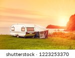 trailer motor home and a tent... | Shutterstock . vector #1223253370