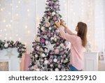white girl in a knitted dress...   Shutterstock . vector #1223295910