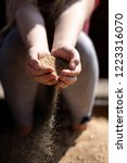 Small photo of transience of time - sand in children's hands as a symbol of inevitable maturation