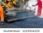workers regulate tracked paver... | Shutterstock . vector #1223316223