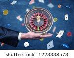 a businessman holds a casino... | Shutterstock . vector #1223338573