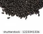 black cumin seeds.top view.... | Shutterstock . vector #1223341336