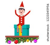 elf sitting on gift boxes. cute ... | Shutterstock .eps vector #1223345956