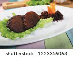typical indonesian empal fried... | Shutterstock . vector #1223356063