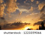 sunset over the village.... | Shutterstock . vector #1223359066