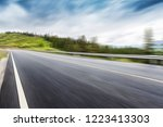 the highway is in green forest. | Shutterstock . vector #1223413303