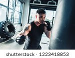 young sportsman wearing boxing... | Shutterstock . vector #1223418853