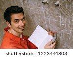 repairman using notebook and... | Shutterstock . vector #1223444803