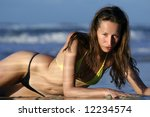 model in bikinis posing on the... | Shutterstock . vector #12234574