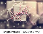 small gift box on top of a pile ... | Shutterstock . vector #1223457790