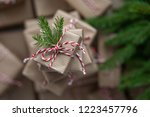 small gift box on top of a pile ... | Shutterstock . vector #1223457796