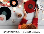 red haired woman puts a... | Shutterstock . vector #1223503639