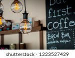rustic lamps in the modern cafe | Shutterstock . vector #1223527429