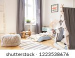 grey drapes at window and pouf... | Shutterstock . vector #1223538676