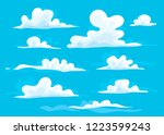 cartoon style clouds. blue sky...   Shutterstock .eps vector #1223599243