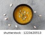 cream of pumpkin in bowl.... | Shutterstock . vector #1223620513