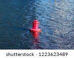 red beacon buoy floating in... | Shutterstock . vector #1223623489