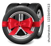 vector car wheels with red bow... | Shutterstock .eps vector #1223645413