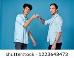 two cheerful men greet fists    ... | Shutterstock . vector #1223648473