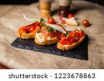 bruschetta with ham parmesan... | Shutterstock . vector #1223678863
