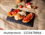 bruschetta with ham parmesan... | Shutterstock . vector #1223678866