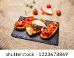 bruschetta with ham parmesan... | Shutterstock . vector #1223678869