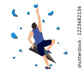 man climbs on a climbing wall... | Shutterstock .eps vector #1223682136