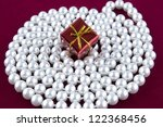 gift box on pearl | Shutterstock . vector #122368456