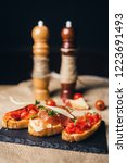 bruschetta with ham parmesan... | Shutterstock . vector #1223691493
