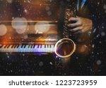 a man hands holding saxophone... | Shutterstock . vector #1223723959