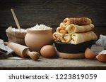 frying pan of baked pancakes ...   Shutterstock . vector #1223819059