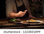Stock photo chef taking pictures of pasta in restaurant kitchen 1223831899