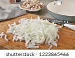 a mound of diced onions on a... | Shutterstock . vector #1223865466