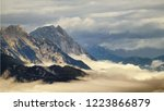high mountain peaks rising from ... | Shutterstock . vector #1223866879